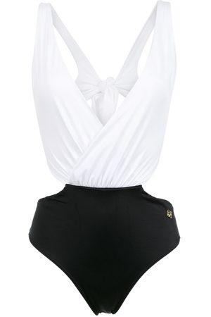 Brigitte Luna cut out swimsuit