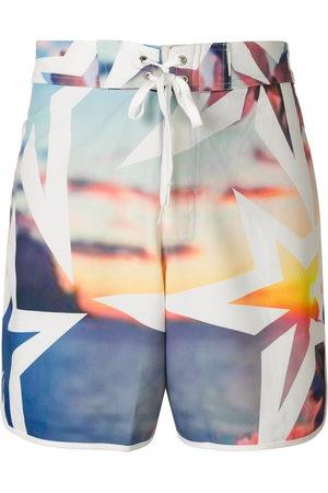 Perfect Moment Super Mojo print swim shorts