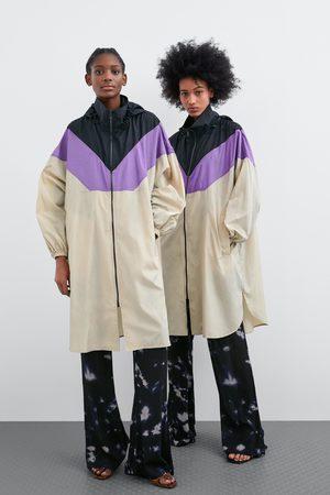 Zara Regenjacke in colorblock-optik mit aufbewahrungstasche