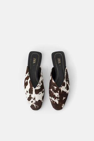 Zara Pantolette aus leder mit animalprint