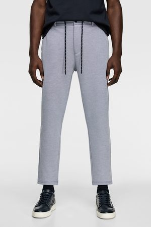 Zara Textured piqué trousers