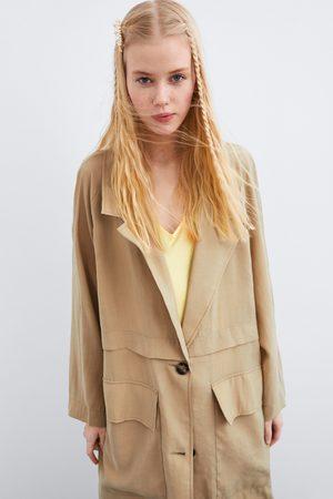 Zara Trenchcoat mit taschen