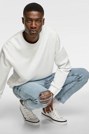 Zara Skinny-jeans im carrot-fit mit rissen