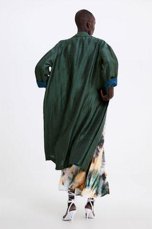 Zara Fliessender trenchcoat mit taschen