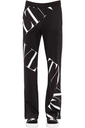 Valentino Herren Hosen & Jeans - Printed Cotton Blend Jersey Track Pants