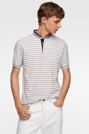 Zara Poloshirt mit kombiniertem streifenmuster