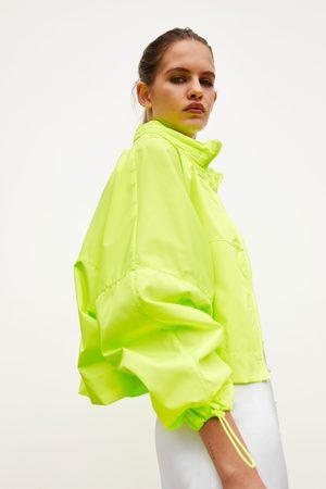 Zara Regenjacke mit packtasche - rucksack