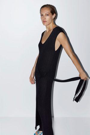 Zara Overall in wickeloptik mit schleifendetail