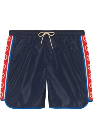 Gucci Herren Badehosen - Nylon swim shorts with logo stripe