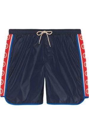 Gucci Herren Badehosen - Nylon swim shorts with logo stripe