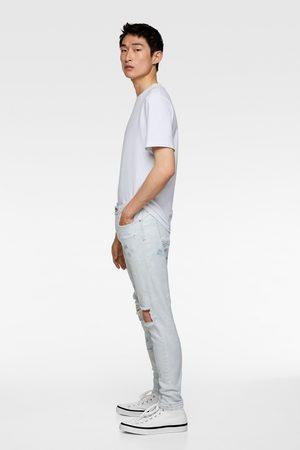 Zara Skinny-jeans mit rissen und farbspritzern