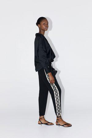 Zara Hose mit seitenstreifen aus spitze