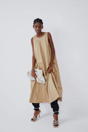 Zara Mittellanges kleid mit taschen