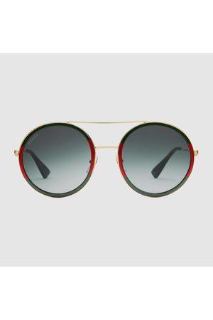 Gucci Sonnenbrille mit rundem Rahmen aus Metall