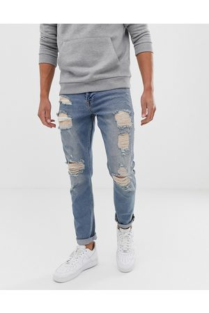 ASOS Stretch slim jeans in vintage light wash with heavy rips