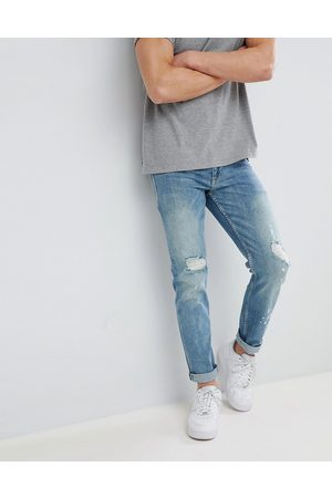 ASOS Stretch slim jeans in mid wash with rips