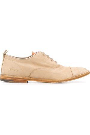 Premiata Distressed lace-up shoes