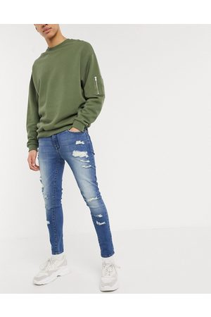 ASOS Spray on jeans in power stretch with heavy rips in mid wash