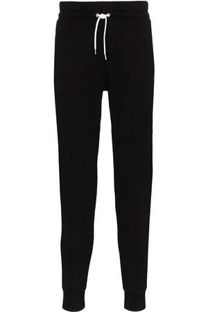Maison Kitsuné Herren Jogginghosen - Tapered leg track pants
