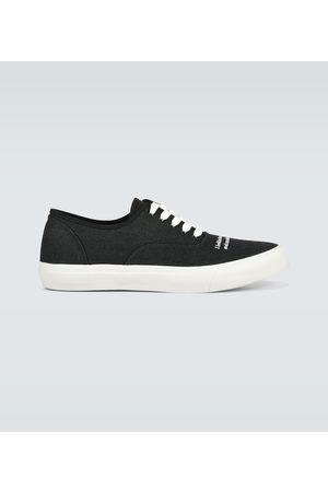 UNDERCOVER Bestickte Sneakers aus Canvas