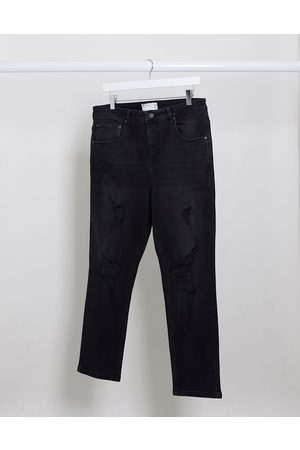 ASOS Tapered jeans in washed with heavy rips