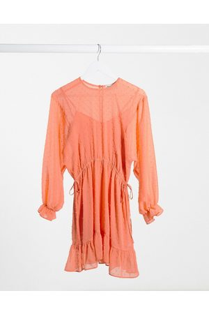 ASOS Dobby batwing mini dress with drawstring waist in coral
