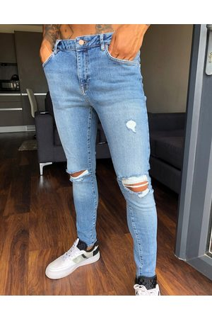 ASOS Spray on'vintage look' jeans with power stretch in mid wash with knee rips