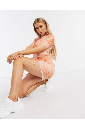 Missguided Mesh mini dress with ruched detail in pink dragon print