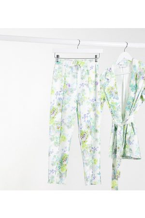 ASOS ASOS DESIGN Petite jersey slim suit trousers in white floral