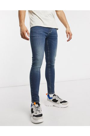 ASOS Spray on jeans with power stretch in dark wash