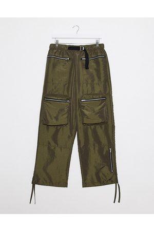ASOS Wide leg trousers in khaki nylon with webbed belt