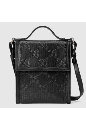 Gucci Herren Umhängetaschen - Umhängetasche aus geprägtem GG Leder