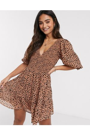 ASOS Shirred mini tiered smock dress with v neck in spot print