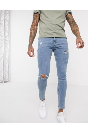ASOS Spray on jeans in power stretch denim in light wash with abrasions