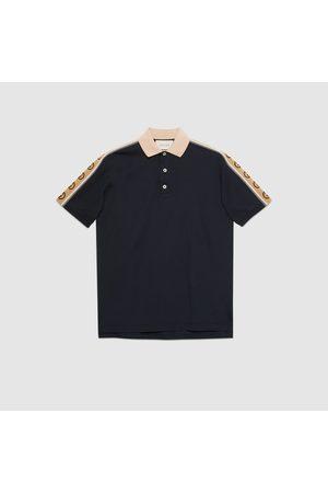 Gucci Poloshirt aus Baumwolle mit GG Streifen
