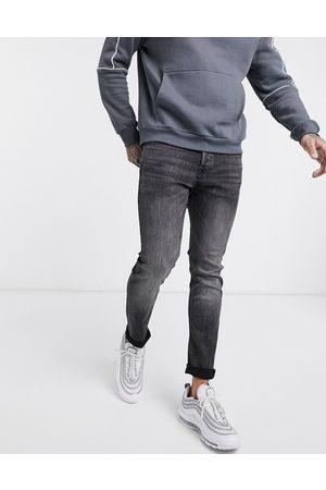 Jack & Jones Intelligence Glenn slim tapered fit jeans in wash