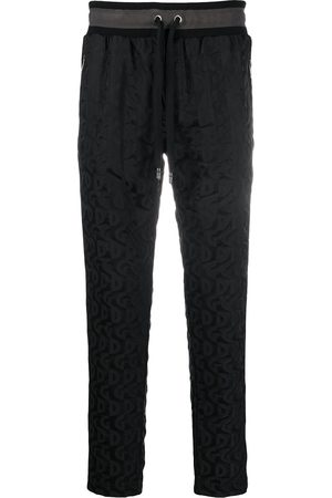 Dolce & Gabbana All-over logo print track pants