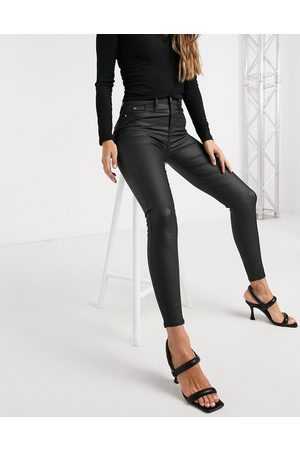 River Island Molly waxed coated skinny jeans in