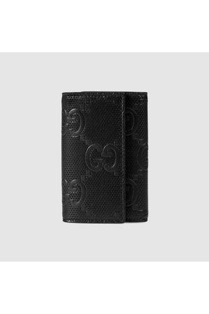 Gucci Herren Geldbörsen & Etuis - Schlüsseletui aus geprägtem GG Leder