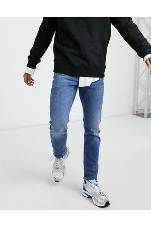ASOS Stretch slim jeans in vintage mid wash