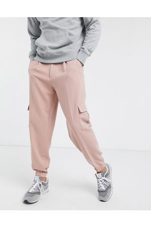 ASOS Oversized tapered smart jogger trousers in with cargo pocket