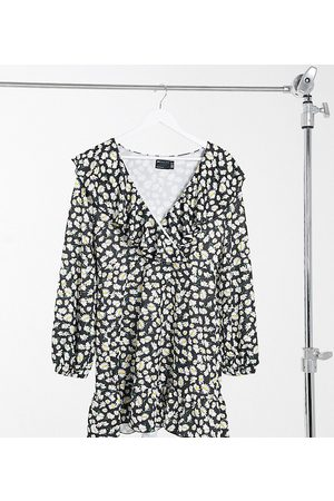ASOS ASOS DESIGN Curve mini wrap dress with frill neck and pep hem in base daisy print