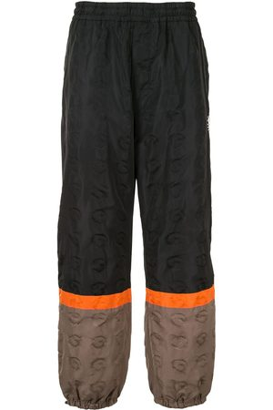 UNDERCOVER Colour-block track pants