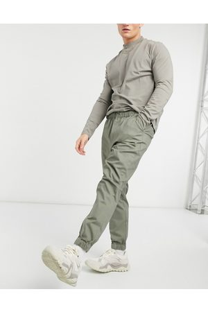 ASOS Tapered chino joggers with elasticated waist in khaki