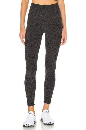 Beyond Yoga Caught In The Midi Legging in - Charcoal. Size L (also in M, S, XS).