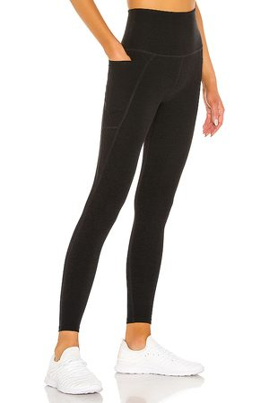 Beyond Yoga Out Of Pocket Legging in - Black. Size L (also in M, S, XS).