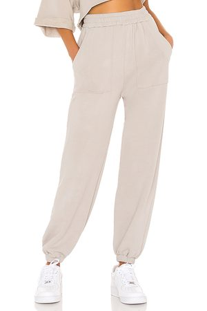 Lovers + Friends Pocket Jogger in - Taupe. Size L (also in M, S, XL, XS, XXS).