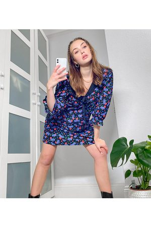 ASOS ASOS DESIGN Tall mini swing dress with black contrast collar in and blue floral