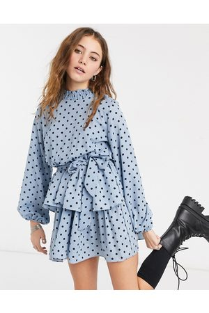 In The Style X Olivia Bowen high neck skater dress with belt in blue polka print