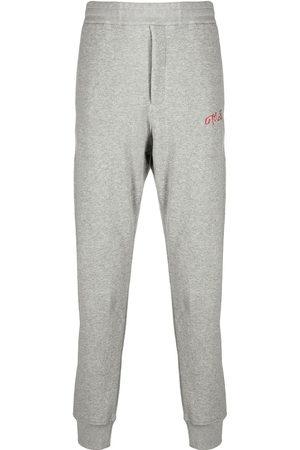 Alexander McQueen Herren Jogginghosen - Embroidered logo track trousers